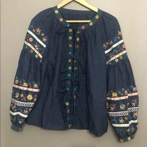 Embroidered tassel tie front cotton blouse